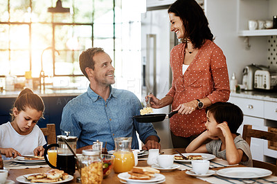 Buy stock photo Cropped shot of a family enjoying breakfast together at home