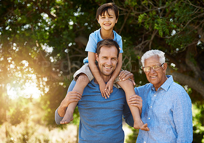 Buy stock photo Portrait of a cute boy posing outside with his father and grandfather