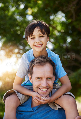 Buy stock photo Portrait of a father and his young son spending quality time together outside