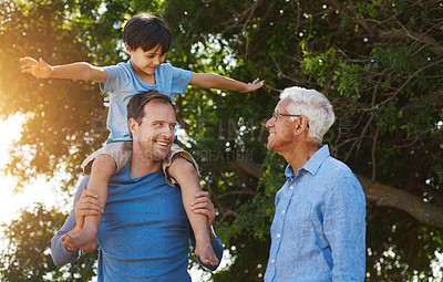 Buy stock photo Portrait of a young boy spending quality time outside with his father and grandfather