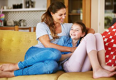 Buy stock photo Shot of a mother and her little daughter bonding together at home