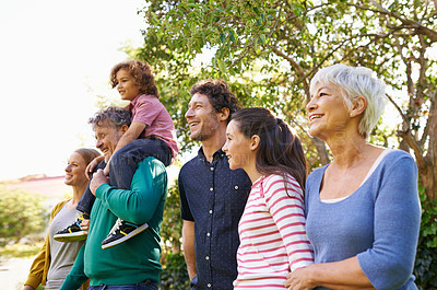 Buy stock photo Shot of a family standing outdoors in the shade