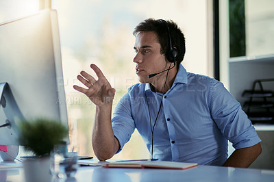 Buy stock photo Cropped shot of a call centre agent working in an office