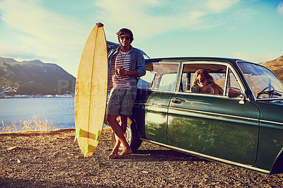 Buy stock photo Portrait of a happy young couple posing with their car on a roadtrip