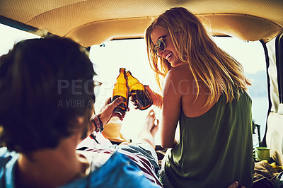 Buy stock photo Rearview shot of a young couple relaxing inside their car during a roadtrip