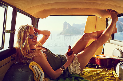Buy stock photo Portrait of a young woman relaxing in the back of her car  on a roadtrip