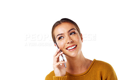 Buy stock photo Shot of a young woman talking on her phone against a white background