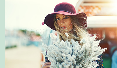 Buy stock photo Portrait of a young woman standing outside with a bouquet of wildflowers