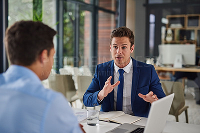 Buy stock photo Shot of two businessmen having a meeting in an office