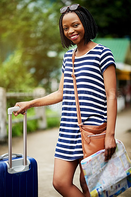 Buy stock photo Portrait of a smiling young woman standing with her suitcase outside in Thailand