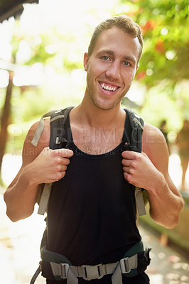 Buy stock photo Portrait of a smiling young man wearing a backpack traveling in Thailand