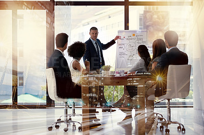 Buy stock photo Multiple exposure shot of businesspeople having a meeting superimposed over a cityscape