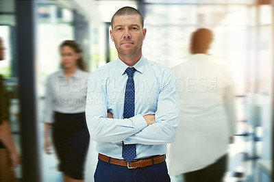 Buy stock photo Portrait of a mature businessman standing in a busy office