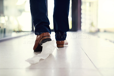 Buy stock photo Closeup shot of a businessman walking in an office with toilet paper stuck to his shoe