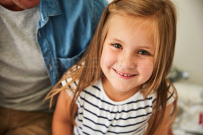 Buy stock photo Portrait of a smiling little girl sitting with her father at home