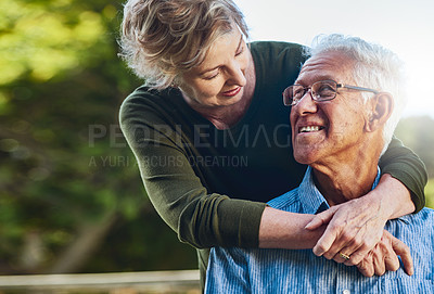 Buy stock photo Shot of a mature couple posing together in their backyard