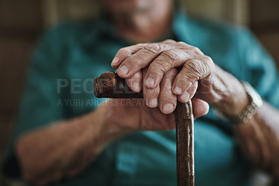 Buy stock photo Cropped shot of an unrecognizable man leaning on his walking stick
