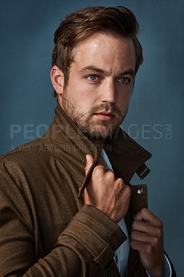Buy stock photo Studio shot of a handsome young man looking thoughtful against a dark background