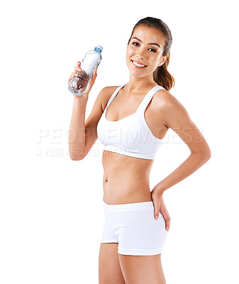 Buy stock photo Portrait of a healthy young woman drinking a bottle of water
