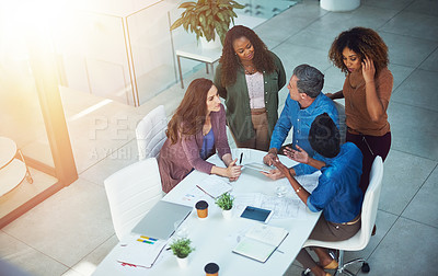 Buy stock photo High angle shot of a group of designers having a meeting in an office