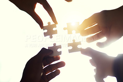Buy stock photo Cropped shot of four people holding puzzle pieces together
