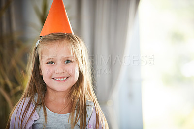 Buy stock photo Portrait of a happy little girl enjoying a birthday party at home