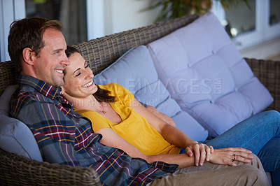 Buy stock photo Cropped shot of an affectionate couple sitting together