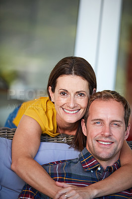 Buy stock photo Cropped shot of a woman hugging her husband from behind