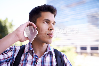Buy stock photo Cropped shot of a young man taking a break from his bike ride to make a phonecall