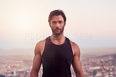Buy stock photo Cropped shot of a sporty young man against a city background