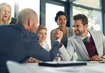 Buy stock photo Cropped shot of businesspeople arm wrestling in an office