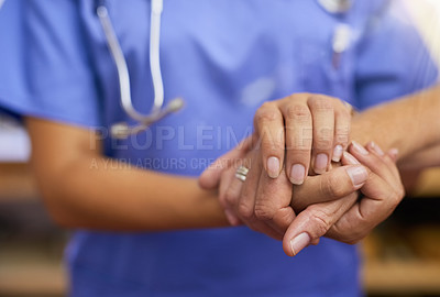Buy stock photo Cropped shot of a nurse holding a senior woman's hands in comfort