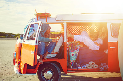 Buy stock photo Shot of an adventurous couple out roadtripping in their mini van