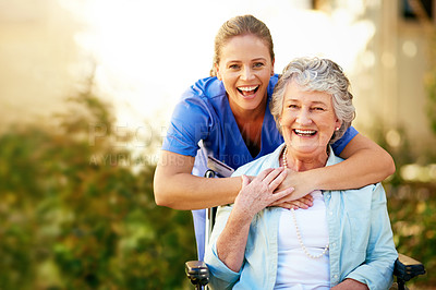 Buy stock photo Cropped portrait of a senior woman outside with her female caregiver