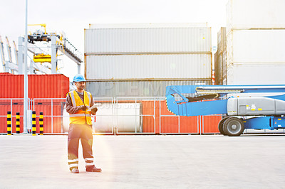 Buy stock photo Shot of a male warehouse worker working on a commercial dock