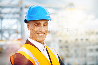 Buy stock photo Shot of a mature male warehouse worker working on a commercial dock