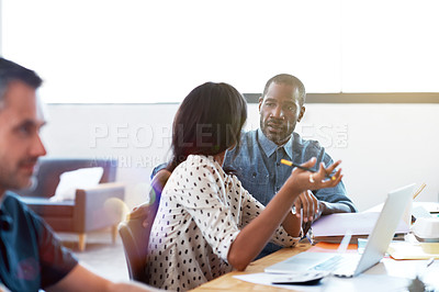 Buy stock photo Shot of two professional businesspeople working together in the office