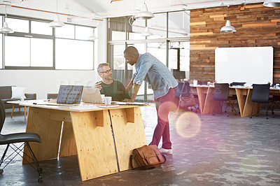Buy stock photo Shot of two mature businessmen working in a creative office