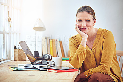 Buy stock photo Shot of an attractive and mature woman working on her laptop at home