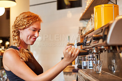 Buy stock photo Shot of a barista on duty in a coffee shot
