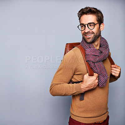 Buy stock photo Studio shot of a handsome young man posing against a gray background