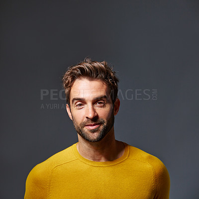 Buy stock photo Studio portrait of a handsome young man posing against a gray background