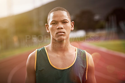 Buy stock photo Portrait of an athletic young man standing outside on the track