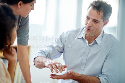 Buy stock photo Shot of a group of coworkers having a discussion in the office