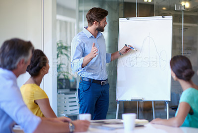 Buy stock photo Cropped shot of a handsome young man giving a business presentation