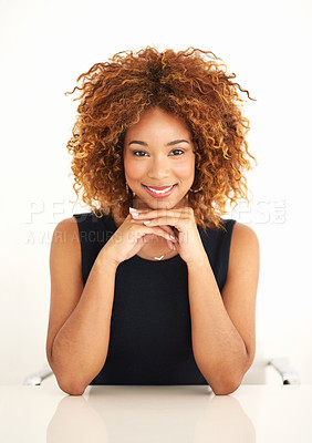 Buy stock photo Portrait of an attractive young businesswoman sitting at her desk