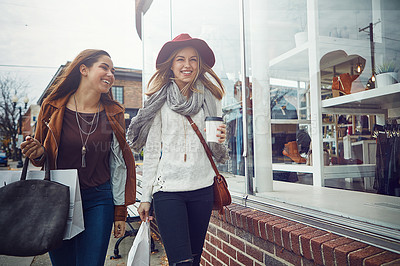 Buy stock photo Shot of two young women out on a shopping spree