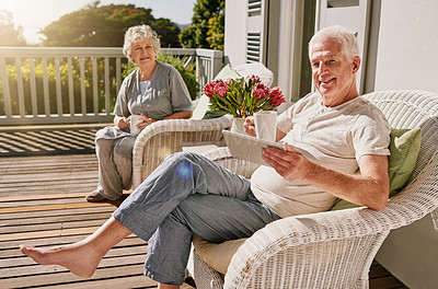 Buy stock photo Shot of a happy senior man enjoying some coffee with his wife on the patio at home
