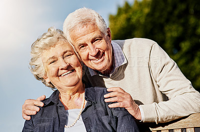 Buy stock photo Shot of a happy senior couple relaxing together outdoors