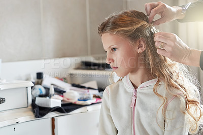 Buy stock photo Shot of a little girl getting her hair done before a celebration event